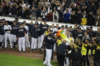 CC Sabathia and Brett Gardner give Derek Jeter his much deserved Gatorade shower.  (Photo: Stefanie Gordon)
